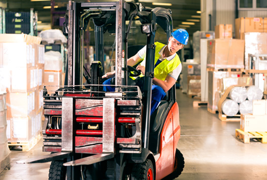 A forklift truck driver in a warehouse